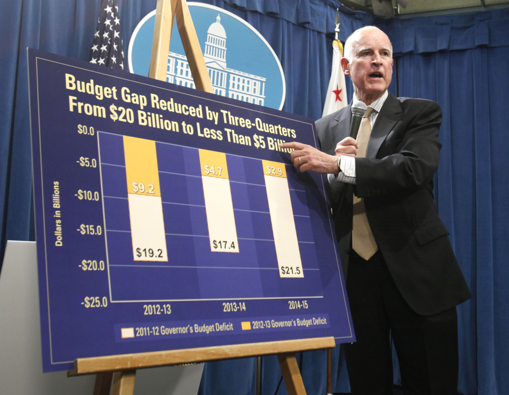 Gov. Jerry Brown discusses the cuts he has already made to help reduce the state's budget deficit by more than half as he unveiled his proposed 2012 billion state budget at a Capitol news conference in Sacramento, Calif.