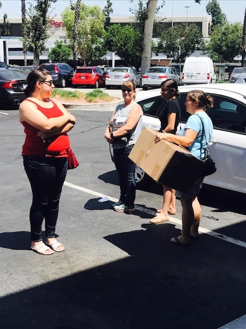 Natalie Buck (left) waits anxiously with other customers in hopes someone will find her bridesmaid dress.