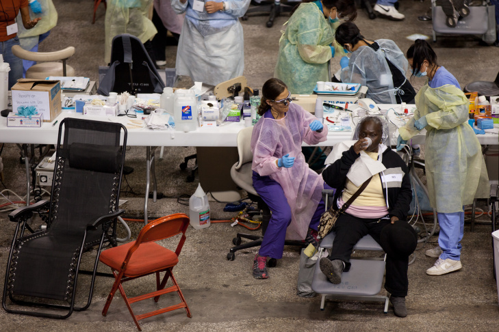 People give their medical history to nurses during a free health clinic at the Los Angeles Memorial Sports Arena on Oct. 20, 2011 in Los Angeles, California.