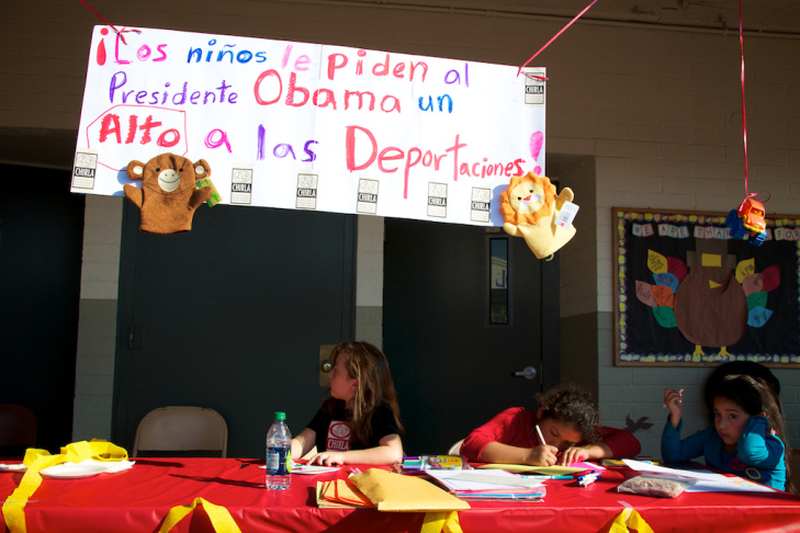 Volunteer Guadalupe Flores passes out food during CHIRLA's event on Nov. 23, 2011.