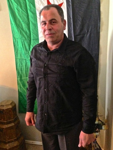 Omar Chamma keeps a Syrian flag in his Fountain Valley home. He's travelled to the Syrian border seven times in the past year.