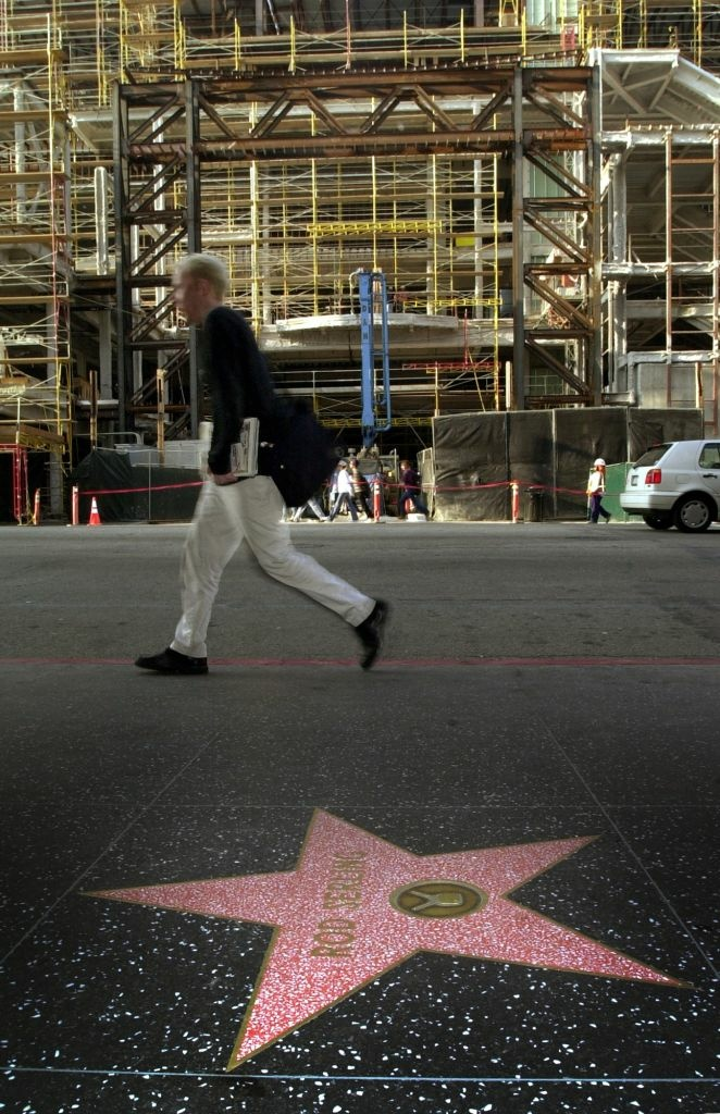 A pedestrian walks next to Rod Serling's star in Hollywood, California.