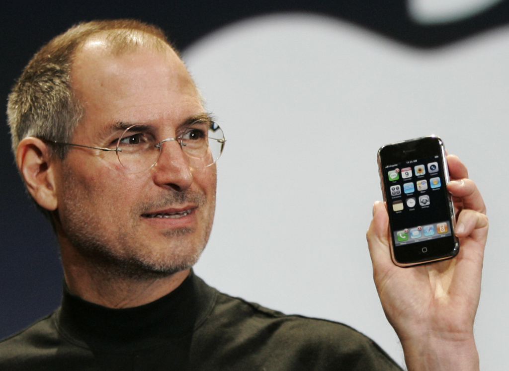 File: Apple CEO Steve Jobs demonstrates the new iPhone during his keynote address at MacWorld Conference.