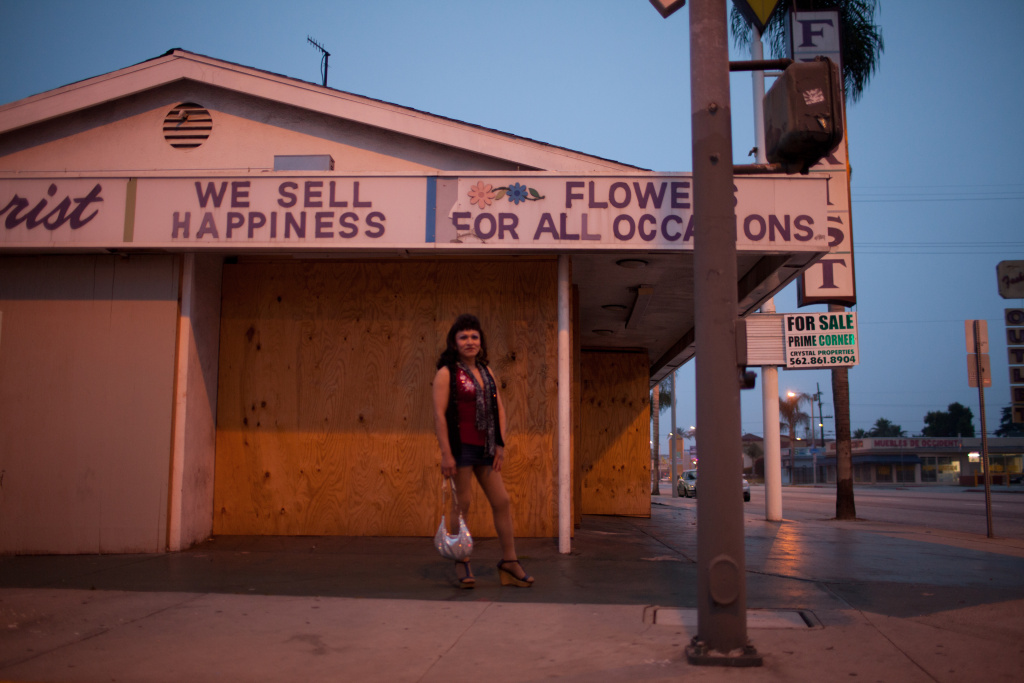 Maria waits for clients on Pacific Boulevard in Walnut Park. She has been working this same street for thirty years.