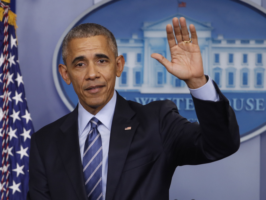 President Barack Obama waves at the conclusion of his news conference in the briefing room of the White House in Washington on Dec. 16, 2016.