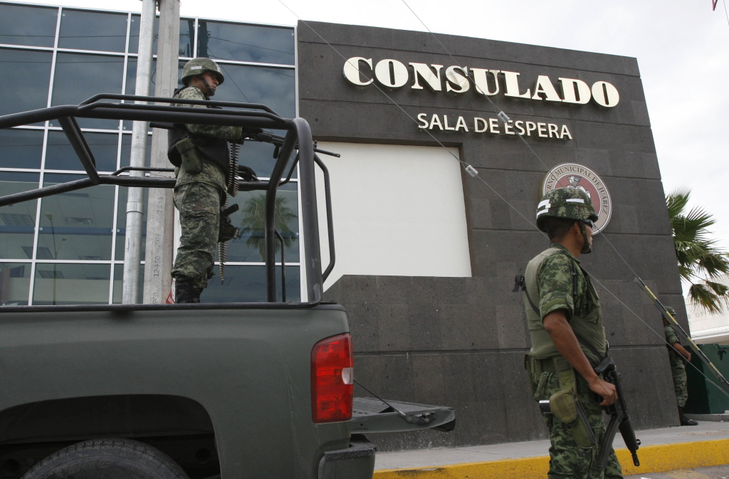 Mexican soldiers guard one of the entrances of the United States consulate in Ciudad Juarez, Chihuahua state, Mexico on July 30, 2010. The United States has closed its consulate in the Mexican border city of Ciudad Juarez to carry out a security review amid spiraling drug gang-related violence, officials said Friday. The indefinite shutdown of the facility comes after the fatal shootings in March of three people linked to the US consulate in Ciudad Juarez, Mexico's notorious crime capital. AFP PHOTO/STR (Photo credit should read STR/AFP/Getty Images)