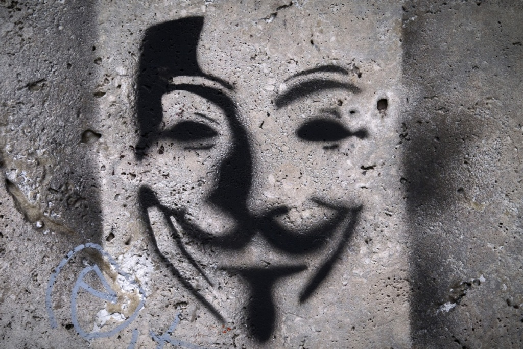 Picture of a painting on a wall representing Anonymous Guy Fawkes mask taken in a street of Paris, on April 24, 2012.