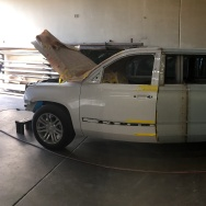 A stretch Escalade getting prepped.