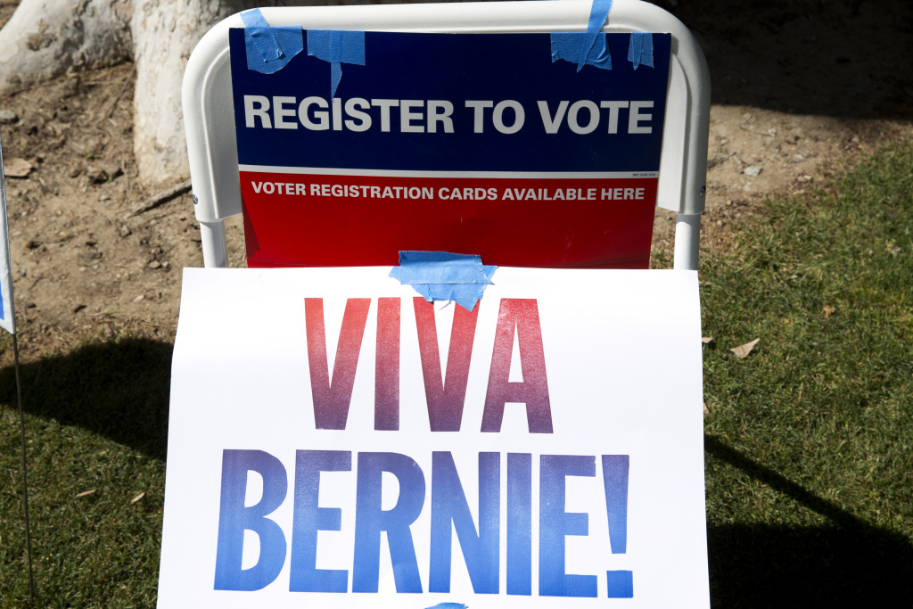 A Bernie Sanders campaign sign outside a voter registration booth at the College of the Canyons in Santa Clarita, California.