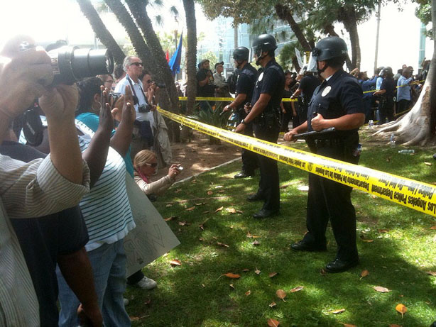 Police in riot gear formed a line in front of a crowd of about 500 people gathered south of City Hall today to protest a white supremacist rally. One person was beat by counterprotesters as of Saturday afternoon.