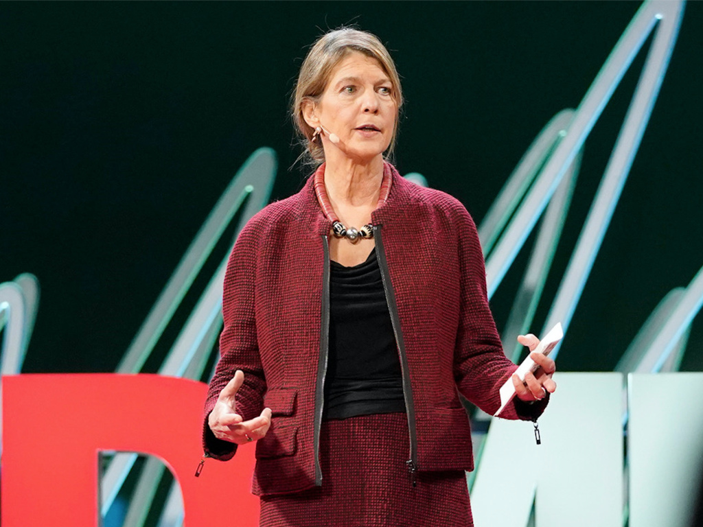 Heidi Larson speaks from the TED stage.
