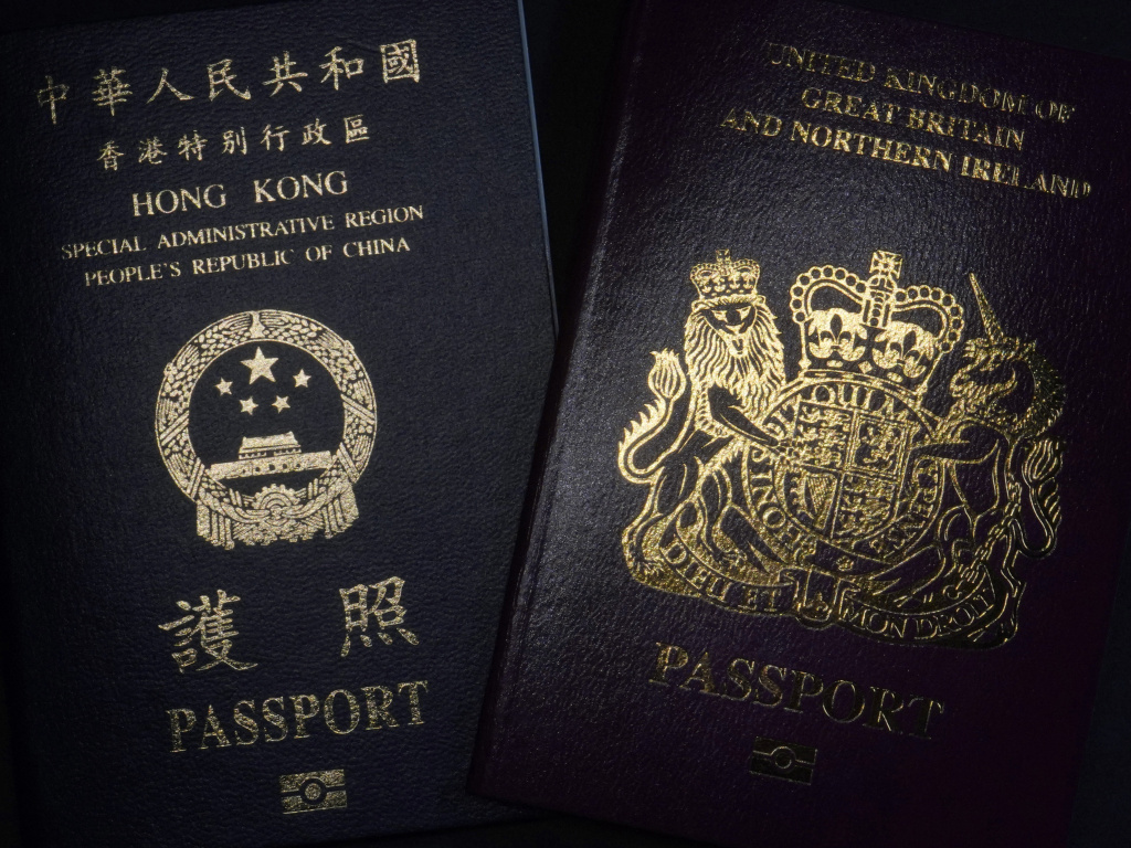 A British National Overseas passport (BNO) and a Hong Kong Special Administrative Region of the People's Republic of China passport. China said Friday it will no longer recognize the BNO passport as a valid travel document or form of identification amid a bitter feud with London over a plan to allow millions of Hong Kong residents a route to residency and eventual citizenship.