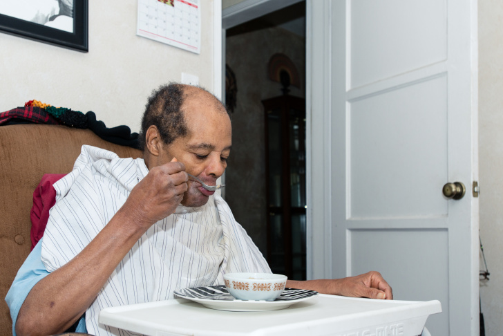 Oliver Massengale, 72, serves his brother oatmeal for breakfast at their house in Compton, Calif. on Friday, January 2, 2015.  Charles Massengale, 71, suffers from dementia, diabetes and high blood pressure and needs constant care.