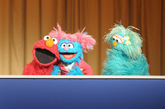 Sesame Street Muppets (L-R) Elmo, Jesse and Rosita address an audience and the press before a special tree planting ceremony promoting the launch of the 'When Families Grieve' support group initiative at Madison Square Park on April 8, 2010 in New York City.