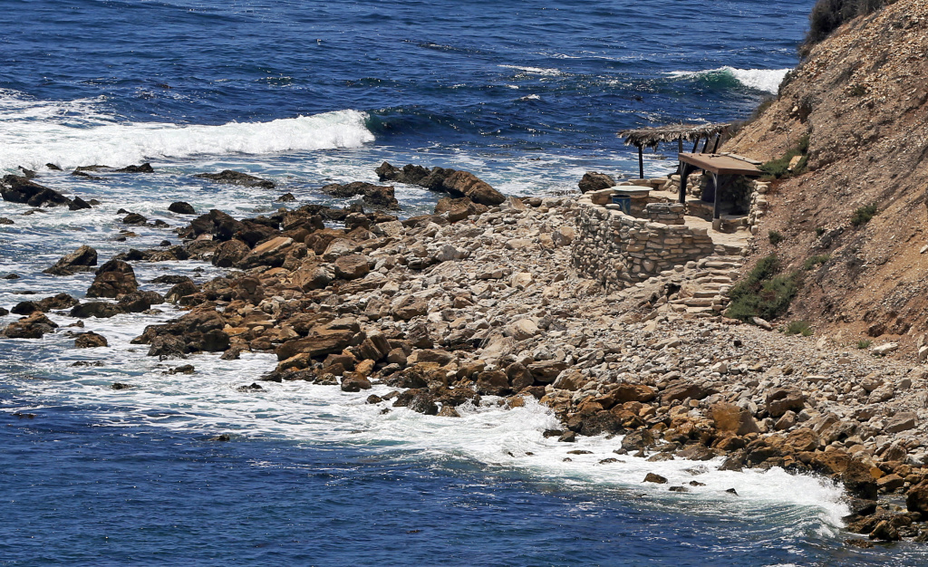 This July 12, 2016, photo shows a stone structure at Rocky Point in Lunada Bay in the tiny, seaside city of Palos Verdes Estates, Calif. The days are numbered for the