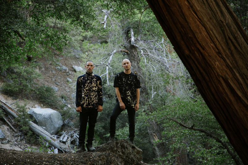 In this photo, Sam Griesemer and Jerome Potter of DJDS are in the woods, not the flames.