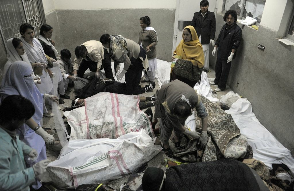 Rescue teams attend the bodies of victims who died in a marketplace bomb blast in Quetta, Pakistan, on Saturday.