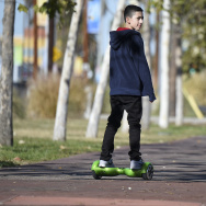 A boy rides a hoverboard on the day after Christmas, in San Pedro, California.