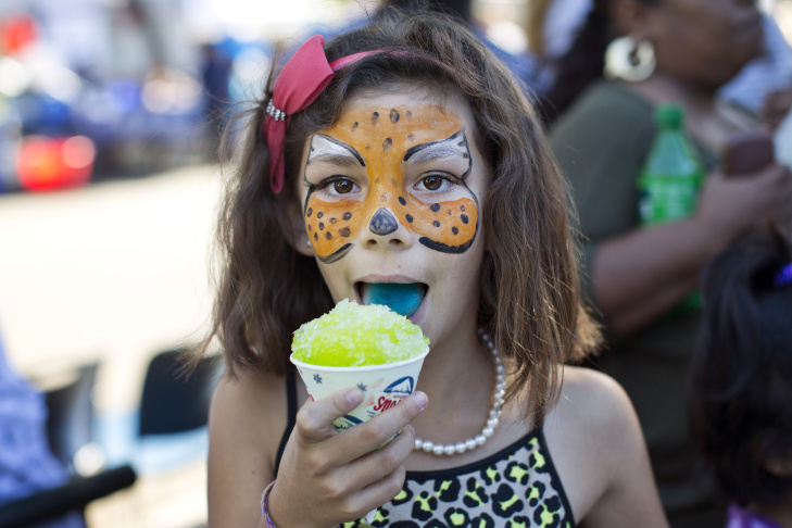 Eight-year-old Angelica Molina licks a snow cone during the 31st annual National Night Out on Tuesday, Aug. 5 in Pasadena.