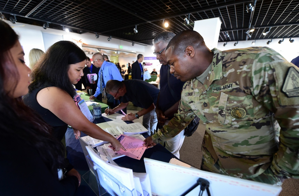US Army Sgt. Kierre Tate (right) inquires about employment prospects at the first Los Angeles International Airport Job Fair for Veterans in Sept. 2016.