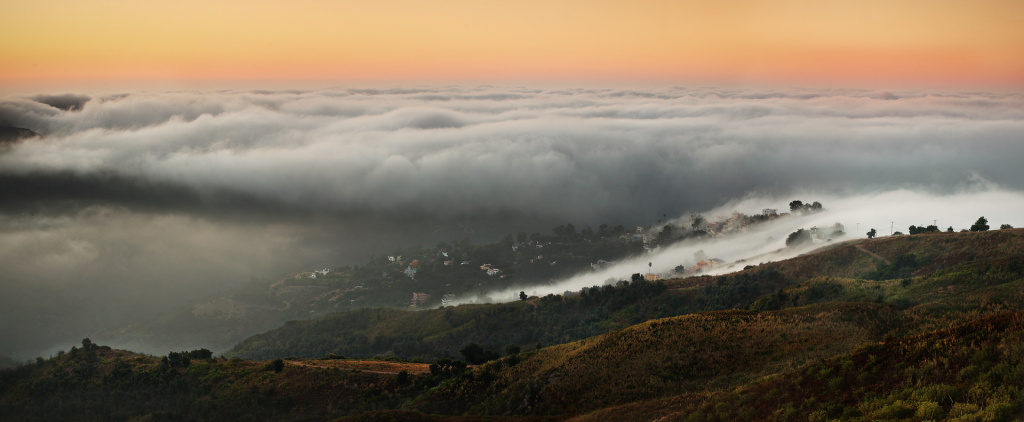 A marine layer blankets Malibu, California, in this stock photo. National Weather Service meteorologist Scott Sukup said the weekend's heat wave would be giving way this week to a cooling trend, with marine layer clouds moving over the coast from Long Beach to Malibu.