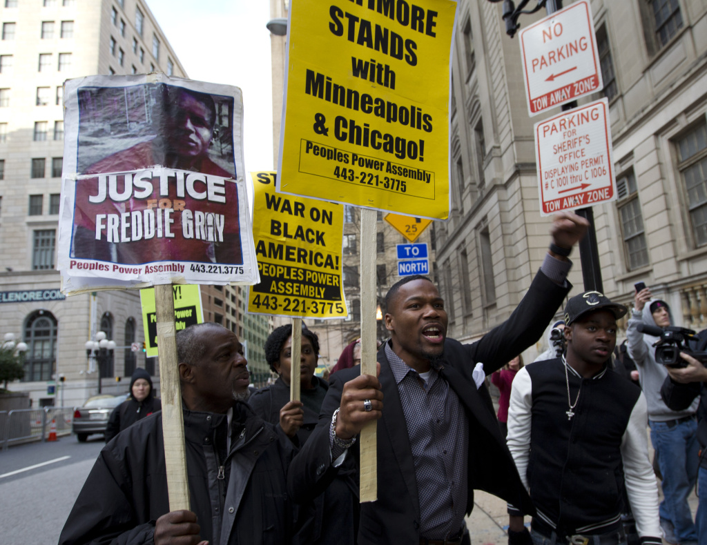 Demonstrators protest outside of the courthouse in response to a hung jury and mistrial for Officer William Porter, one of six Baltimore city police officers charged in connection to the death of Freddie Gray, Wednesday, Dec. 16, 2015, in Baltimore.  (AP Photo/Jose Luis Magana)