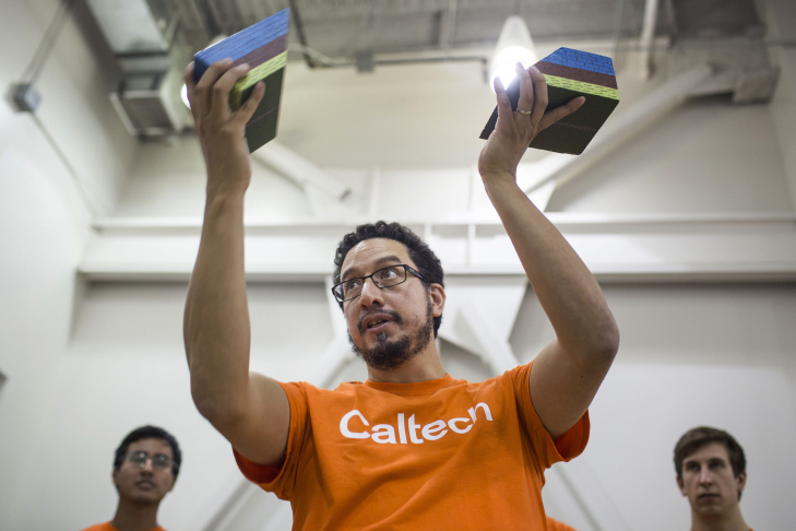 Anthony Massari, a graduate researcher in Caltech's civil engineering department, discusses graphs from a Community Seismic Networks sensor during an all-day bilingual Risk Lab at Sotomayor Learning Academies on Saturday afternoon, Aug. 27 2016. Caltech's CSN distributes seismic sensors to volunteers free of charge across Southern California.