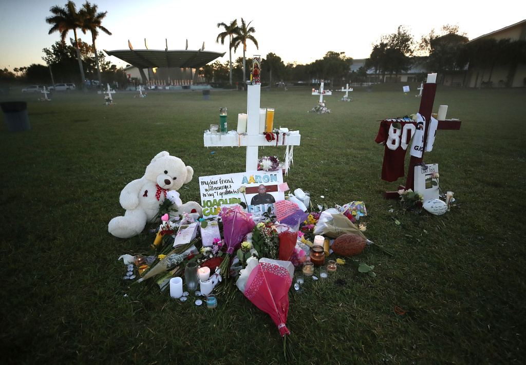 Flowers and mementos are placed on a memorial site for assistant football coach Aaron Feis and others who were killed in the February 14, 2018 shooting at Marjory Stoneman Douglas High School in Parkland, Florida.