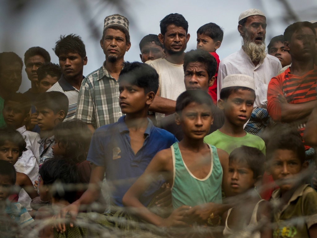 Rohingya refugees gather in the