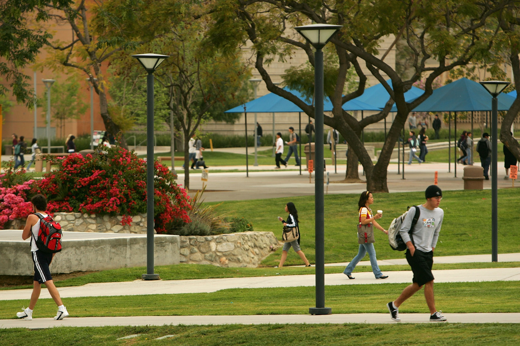 Students walk between classes on the California State University, Fullerton campus.