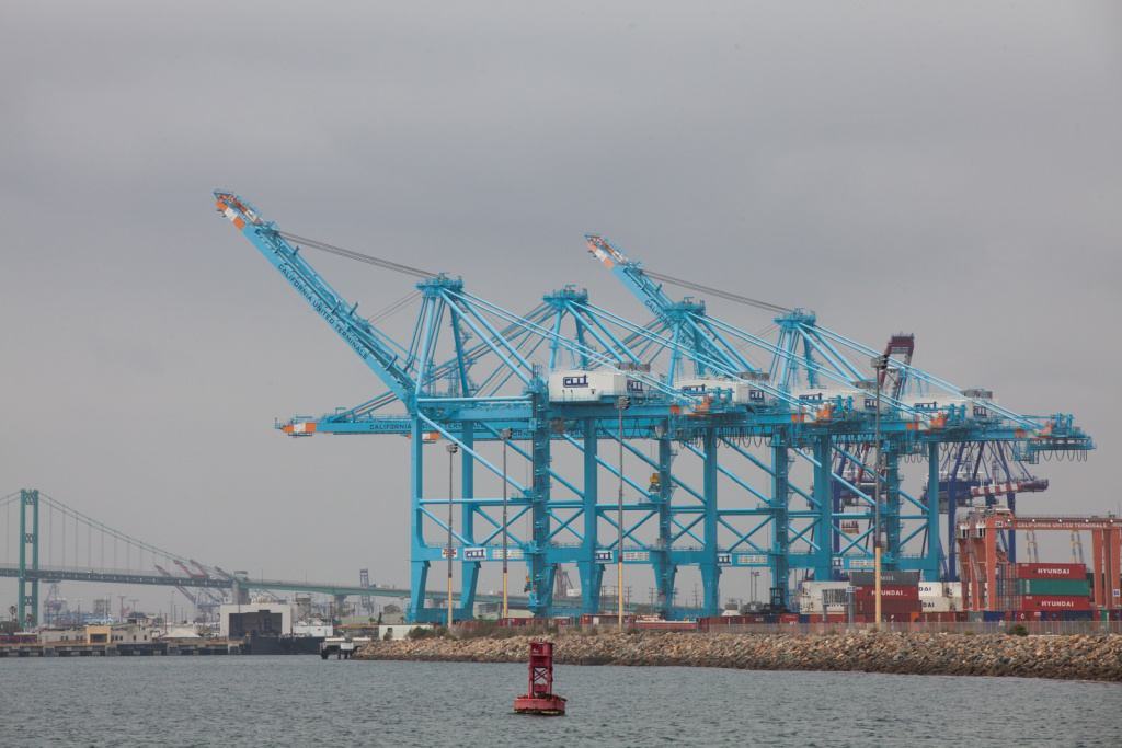 Cranes pick up containers from cargo ships in the Port of Los Angeles which received 2,180 vessels in 2012. A Taiwan company extended a contract with the Port of L.A. which is expected to bring in an additional $300-$500 million.