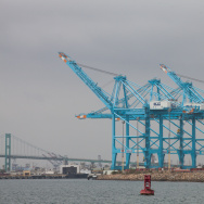 Cranes pick up containers from cargo ships in the Port of Los Angeles .
