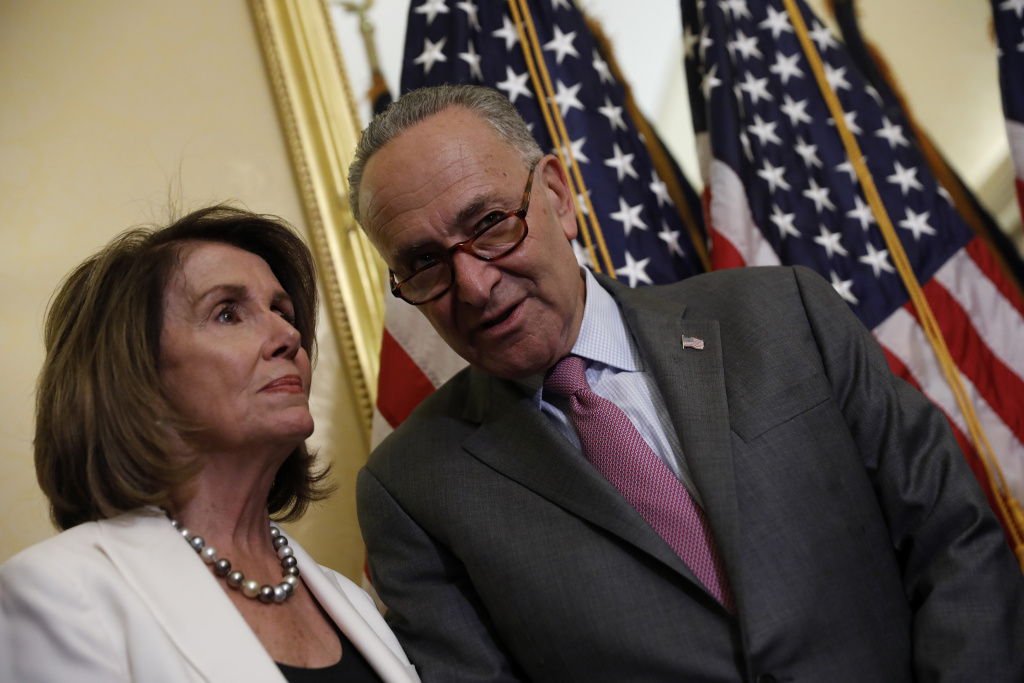Senate Minority Leader Chuck Schumer speaks with House Minority Leader Nancy Pelosi at a news conference on September 14, 2017 in Washington, DC.
