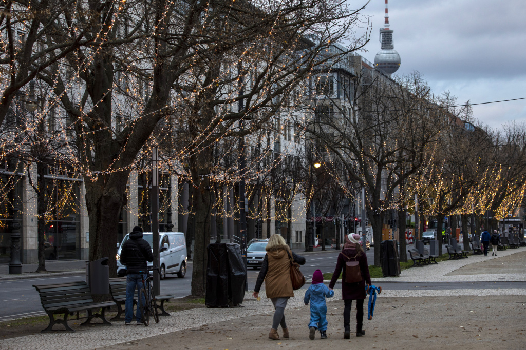 Visitors walk in boulevard Unter den Linden in the city center during the second wave of the coronavirus pandemic on November 19, 2020 in Berlin, Germany.