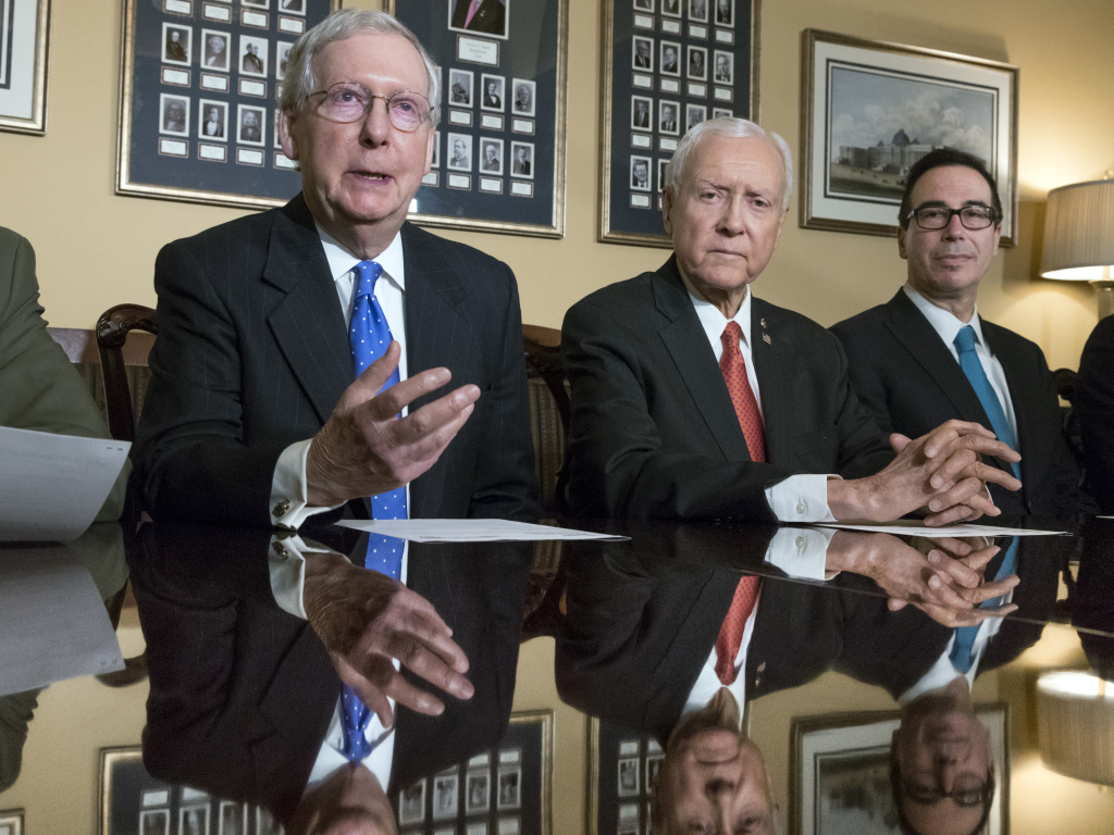 Senate Majority Leader Mitch McConnell, R-Ky., Senate Finance Committee Chairman Orrin Hatch, R-Utah, and Treasury Secretary Steven Mnuchin speak to reporters about the Senate's version of the GOP tax reform bill.