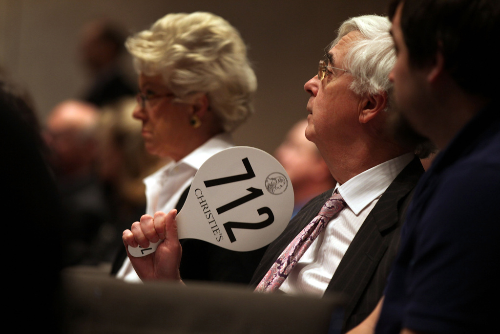 Man places bid at Christie's Auction House on January 20, 2012 in New York City.