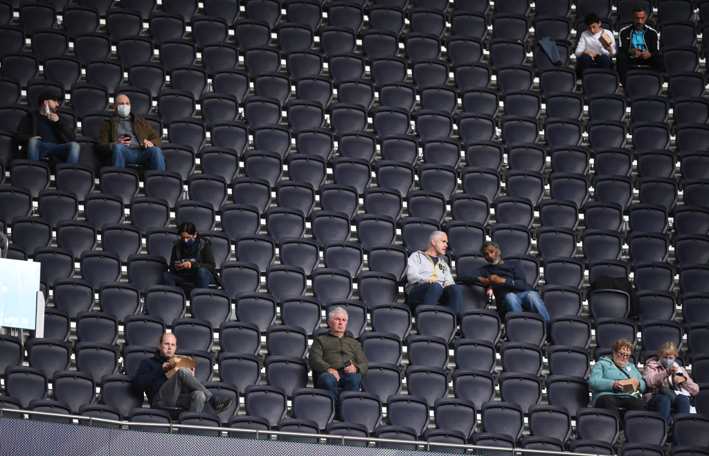 Fans social distance inside the stadium prior to the Premier League match between Tottenham Hotspur and Aston Villa at Tottenham Hotspur Stadium on May 19, 2021 in London, England.