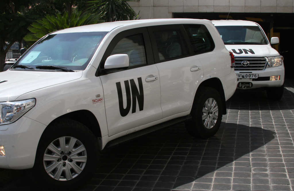 A U.N. team that is scheduled to investigate an alleged chemical attack that killed hundreds last week in a Damascus suburb, leaves their hotel in a convoy, in Damascus, Syria, Monday, Aug. 26, 2013. The team was reportedly fired upon en route to the site.