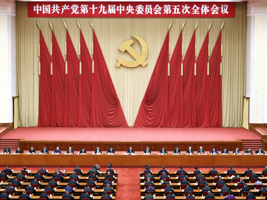 Chinese President Xi Jinping, center, also general secretary of the Chinese Communist Party, leads the fifth plenary session of the party's 19th Central Committee in October in Beijing. The U.S. State Department on Thursday tightened travel restrictions on members of the party and their families.