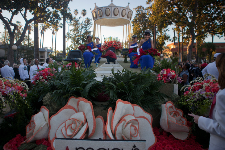 The Rose Parade Royal Court takes their positions on the float that will carry them down Colorado Boulevard.