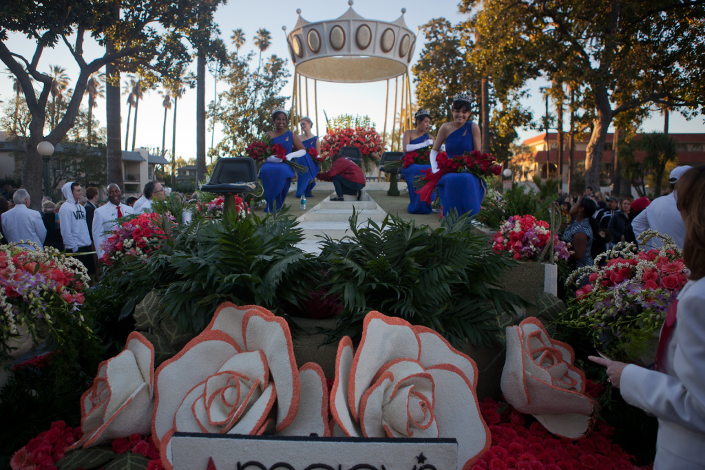 Last year's Rose Parade Royal Court takes their positions on the float that will carry them down Colorado Boulevard.