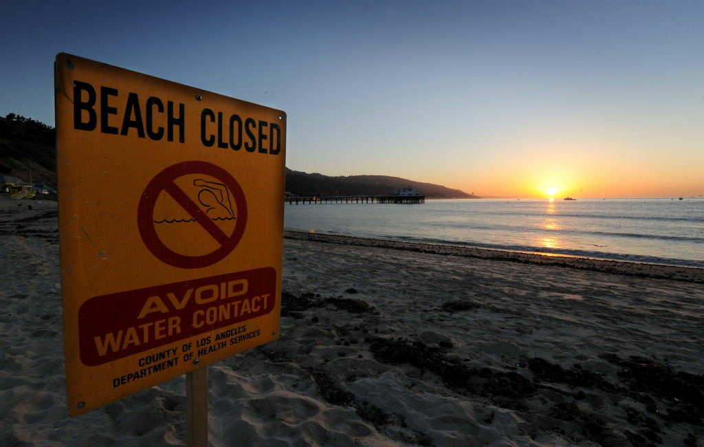 A beach closed sign on October 9, 2010 in Malibu warns against contaminated water due to rain runoff.