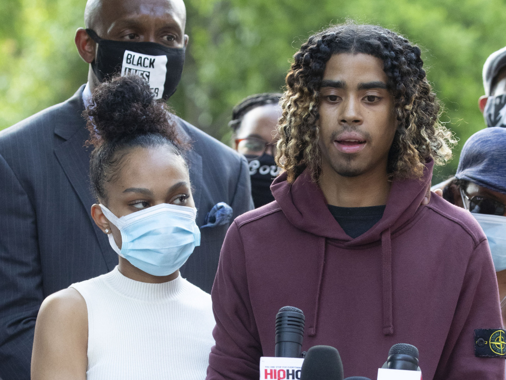 Taniyah Pilgrim and Messiah Young address a news conference Monday at Morehouse College in Atlanta. Prosecutors have filed charges against six officers involved in the couple's arrest Saturday night.