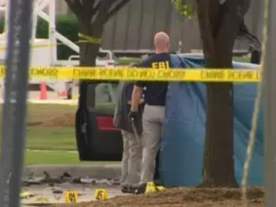 Armed with assault rifles, the two gunmen were killed after opening fire on officers.