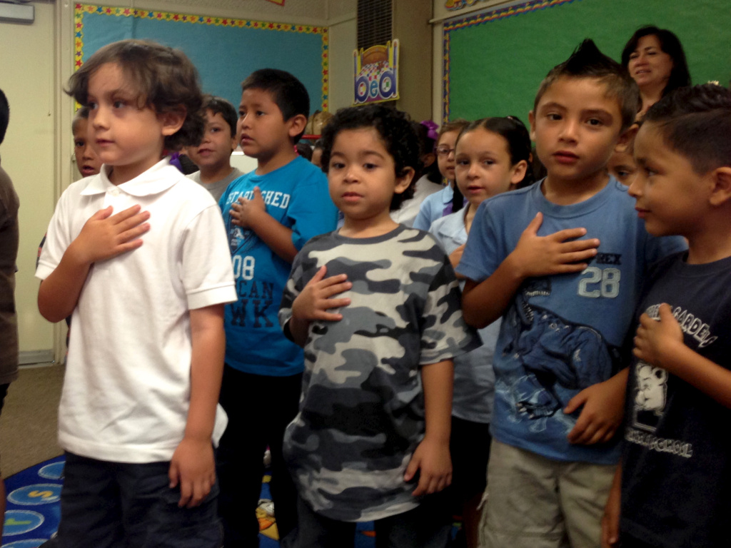 Students at Montebello Gardens Elementary recite the Pledge of Allegiance. The school is part of the Montebello Unified School District.