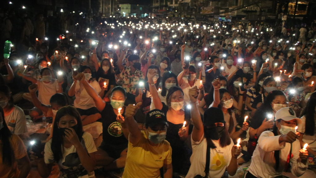 Protesters against last month's military coup hold a candlelight rally in Yangon, Myanmar, on  Saturday. More than 70 people have been killed by security forces since the military overthrew the country's fragile democracy six weeks ago, a United Nations official says.