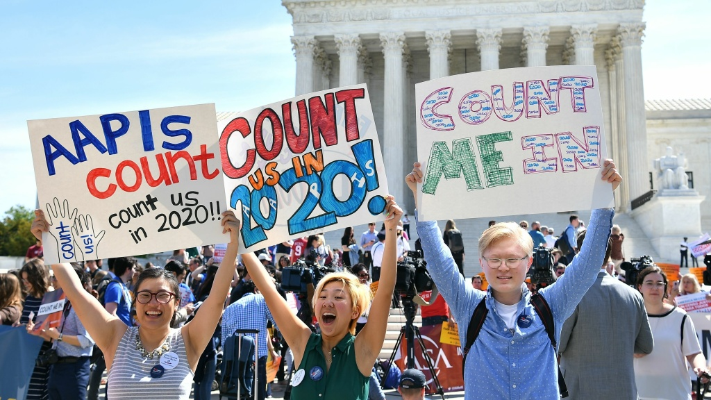 Demonstrators rally outside the U.S. Supreme Court in Washington, D.C., in April to protest the Trump administration's plan to add a citizenship question to forms for the 2020 census.