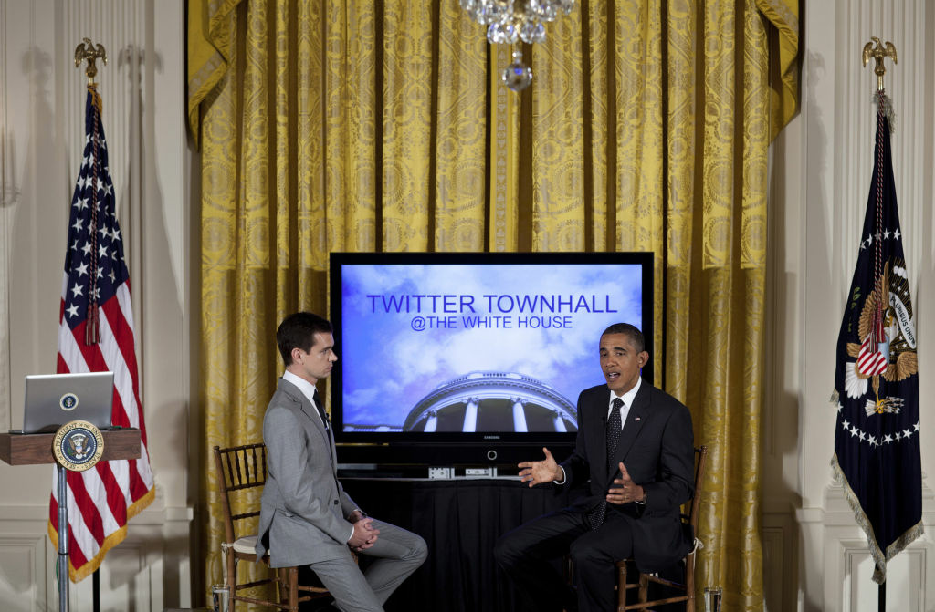 Twitter co-founder and Executive Chairman Jack Dorsey listens while President Barack Obama speaks during an online Twitter town hall meeting from the East Room of the White House July 6, 2011 in Washington, DC.  Obama and Twitter co-founder and Executive Chairman Jack Dorsey held the online discussion to speak about the U.S .debt ceiling crisis.