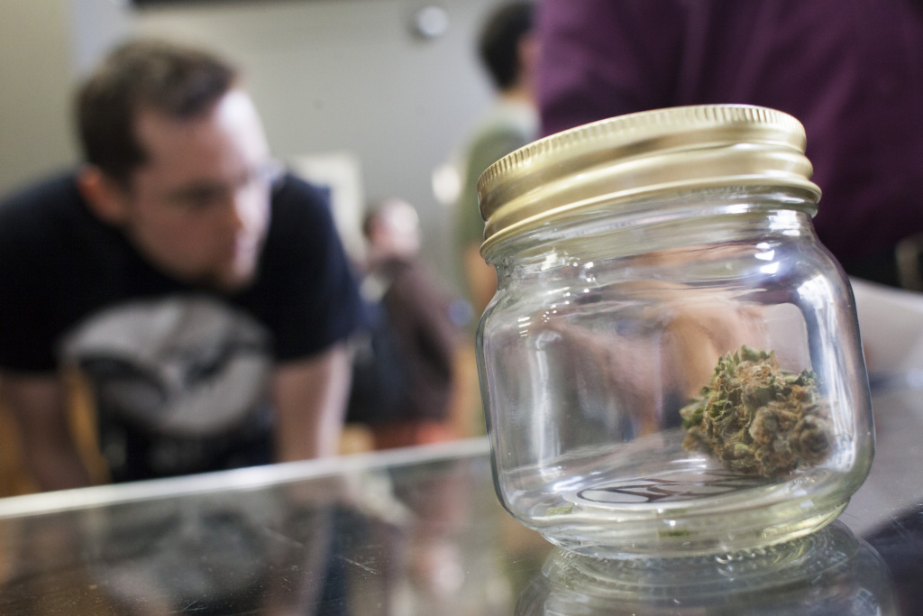 BELLINGHAM, WA - JULY 8: Customers shop for marijuana at Top Shelf Cannabis, a retail marijuana store, on July 8, 2014 in Bellingham, Washington. Top Shelf Cannabis was the first retail marijuana store to open today in Washington state, nearly a year and a half after the state's voters chose to legalize marijuana.  (Photo by David Ryder/Getty Images)