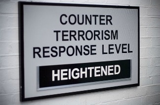 "Sign at the entrance to Portsmouth Dockyard: ""Counter Terrorism Response Level Heightened."""